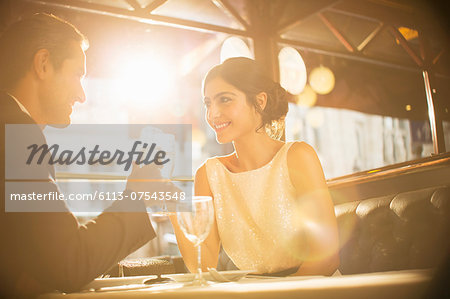 Couple toasting champagne flutes in restaurant Stock Photo - Premium Royalty-Free, Image code: 6113-07543548
