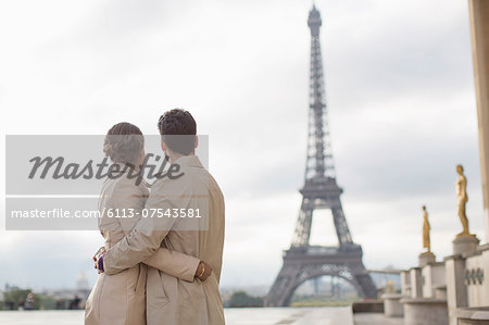 Couple admiring Eiffel Tower, Paris, France Stock Photo - Premium Royalty-Free, Image code: 6113-07543581