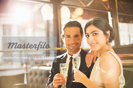 Couple drinking champagne in restaurant Stock Photo - Premium Royalty-Free, Image code: 6113-07543585