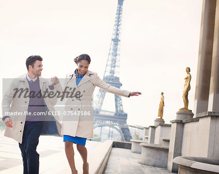 Couple walking in front of Eiffel Tower, Paris, France Stock Photo - Premium Royalty-Free, Image code: 6113-07543586
