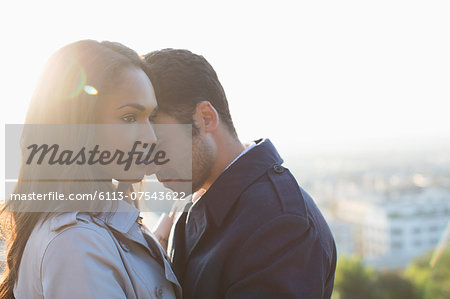 Couple hugging outdoors Stock Photo - Premium Royalty-Free, Image code: 6113-07543622