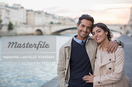 Couple walking along Seine River, Paris, France Stock Photo - Premium Royalty-Free, Image code: 6113-07543664
