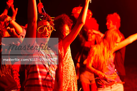 Friends dancing at music festival Stock Photo - Premium Royalty-Free, Image code: 6113-07564782