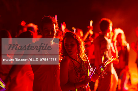 Couple dancing at music festival Stock Photo - Premium Royalty-Free, Image code: 6113-07564783