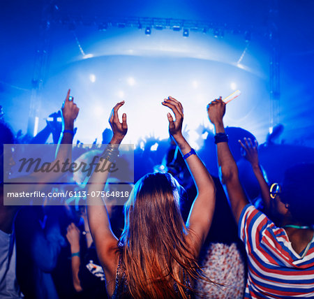 Fans dancing and cheering at music festival Stock Photo - Premium Royalty-Free, Image code: 6113-07564818