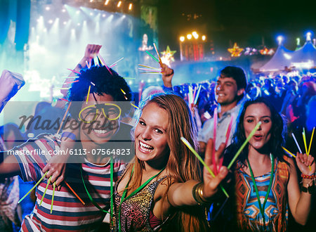 Portrait of friends with glow sticks at music festival Stock Photo - Premium Royalty-Free, Image code: 6113-07564823