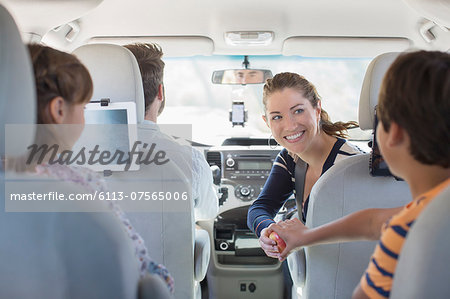 Family inside of car Stock Photo - Premium Royalty-Free, Image code: 6113-07565006