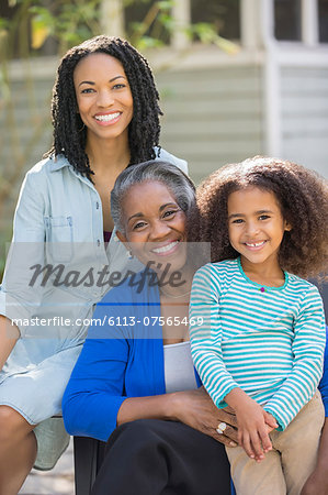 Portrait of smiling multi-generation women outdoors Stock Photo - Premium Royalty-Free, Image code: 6113-07565469