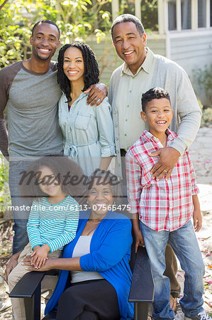 Portrait of smiling multi-generation family outdoors Stock Photo - Premium Royalty-Free, Image code: 6113-07565475