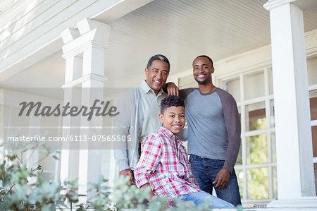 Portrait of smiling multi-generation men on porch
