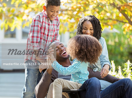 Happy family laughing outdoors