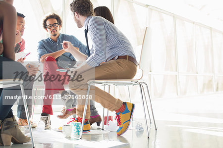 Creative business people meeting in circle of chairs Stock Photo - Premium Royalty-Free, Image code: 6113-07565838