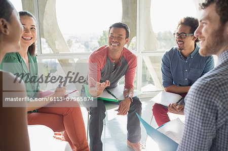 Creative business people meeting in circle of chairs Stock Photo - Premium Royalty-Free, Image code: 6113-07565874