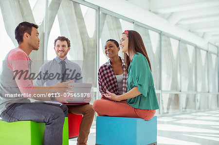 Creative business people meeting on colorful stools Stock Photo - Premium Royalty-Free, Image code: 6113-07565878