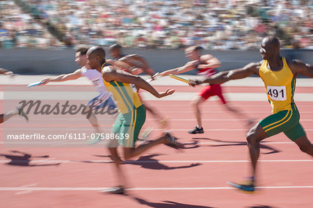 Blurred view of relay runners in race Stock Photo - Premium Royalty-Free, Image code: 6113-07588639