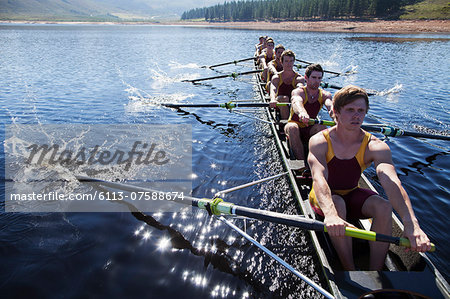 Rowing team rowing scull on lake Stock Photo - Premium Royalty-Free, Image code: 6113-07588674