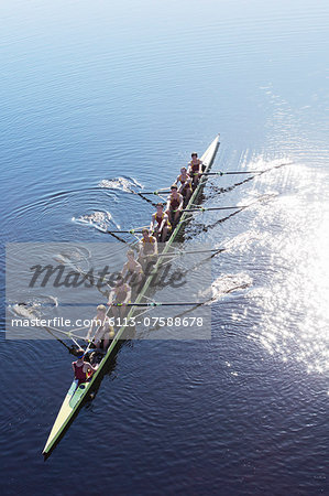 Rowing team rowing scull on lake Stock Photo - Premium Royalty-Free, Image code: 6113-07588678