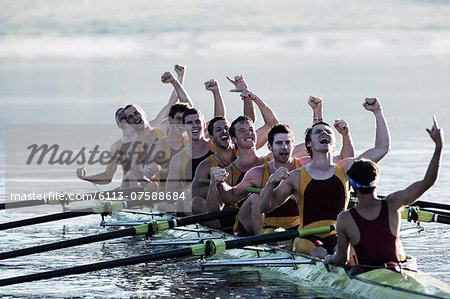Rowing team celebrating in scull on lake Stock Photo - Premium Royalty-Free, Image code: 6113-07588684
