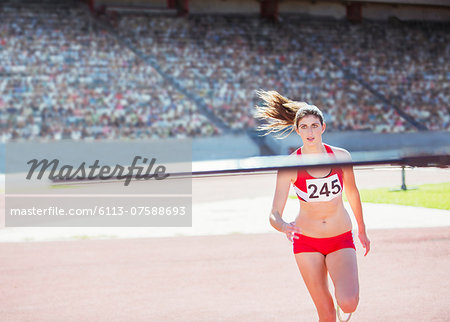 High jumper nearing pole Stock Photo - Premium Royalty-Free, Image code: 6113-07588693