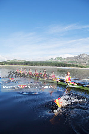Rowing crew rowing scull on lake Stock Photo - Premium Royalty-Free, Image code: 6113-07588698