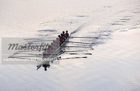 Rowing team rowing scull on lake Stock Photo - Premium Royalty-Free, Image code: 6113-07588713