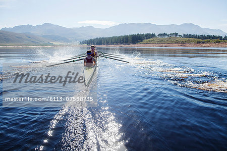 Rowing crew rowing scull on lake Stock Photo - Premium Royalty-Free, Image code: 6113-07588735