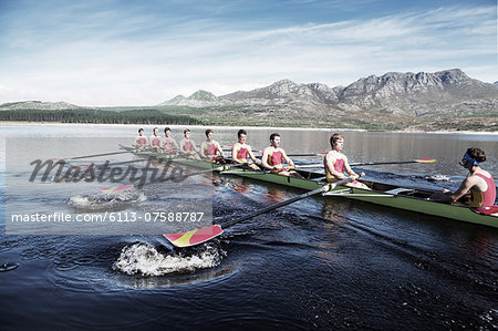 Rowing team rowing scull on lake Stock Photo - Premium Royalty-Free, Image code: 6113-07588787