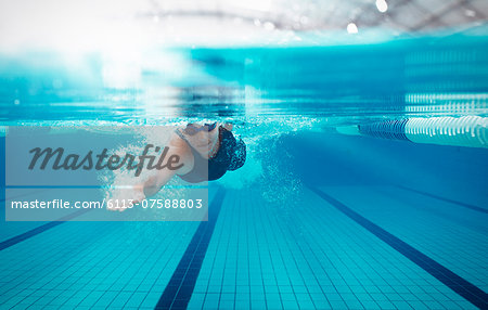 Swimmer racing in pool Stock Photo - Premium Royalty-Free, Image code: 6113-07588803