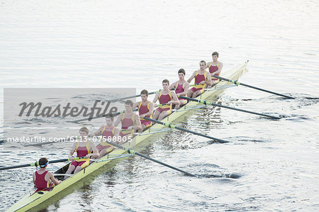 Rowing team rowing scull on lake Stock Photo - Premium Royalty-Free, Image code: 6113-07588805