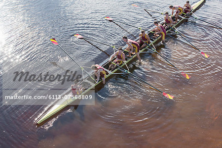 Rowing team in scull on lake Stock Photo - Premium Royalty-Free, Image code: 6113-07588809