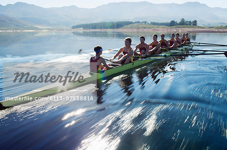 Rowing team rowing scull on lake Stock Photo - Premium Royalty-Free, Image code: 6113-07588814