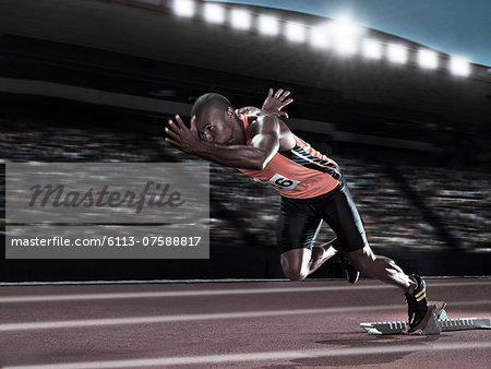 Runner racing on track Stock Photo - Premium Royalty-Free, Image code: 6113-07588817