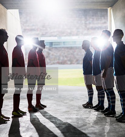 Silhouette of soccer teams greeting in locker room Stock Photo - Premium Royalty-Free, Image code: 6113-07588832