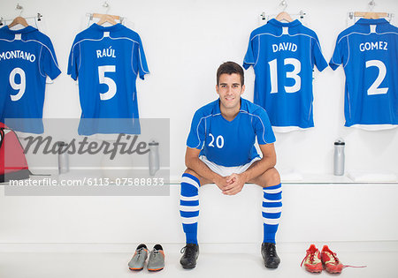 Soccer player sitting in locker room Stock Photo - Premium Royalty-Free, Image code: 6113-07588833