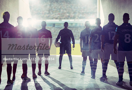 Silhouette of soccer teams facing field Stock Photo - Premium Royalty-Free, Image code: 6113-07588834