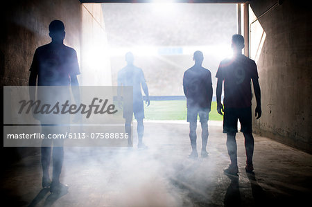 Silhouette of soccer teams facing field Stock Photo - Premium Royalty-Free, Image code: 6113-07588836