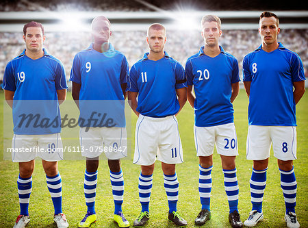 Soccer team standing on field Stock Photo - Premium Royalty-Free, Image code: 6113-07588847