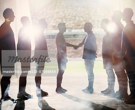 Silhouette of soccer teams shaking hands Stock Photo - Premium Royalty-Free, Image code: 6113-07588858