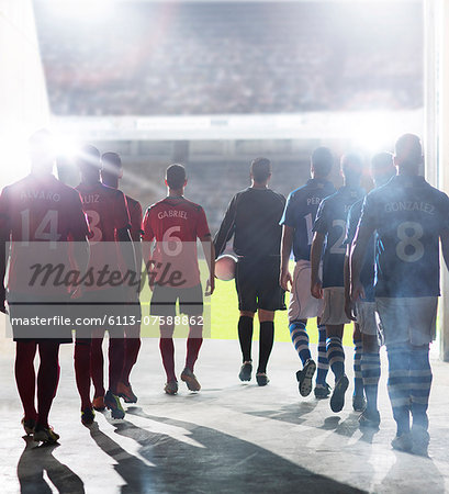 Silhouette of soccer players walking to field Stock Photo - Premium Royalty-Free, Image code: 6113-07588862