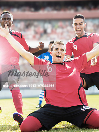 Soccer team celebrating on field Stock Photo - Premium Royalty-Free, Image code: 6113-07588866
