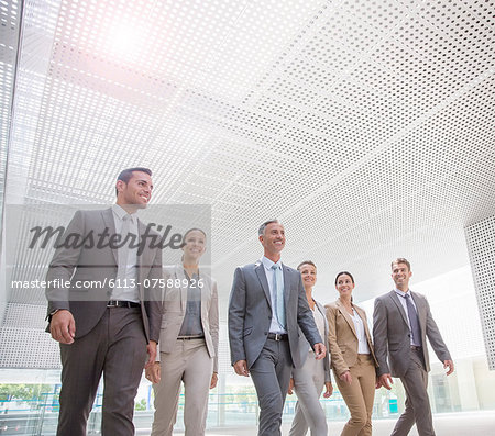 Business people walking Stock Photo - Premium Royalty-Free, Image code: 6113-07588926