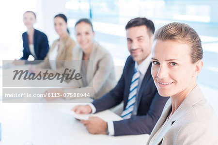 Portrait of confident business people in conference room Stock Photo - Premium Royalty-Free, Image code: 6113-07588944