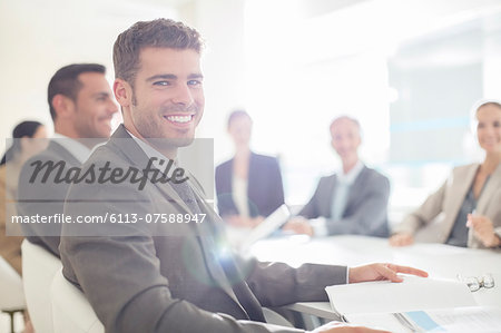 Portrait of confident businessman in conference room Stock Photo - Premium Royalty-Free, Image code: 6113-07588947