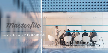 Businesswoman leading meeting in modern conference room Stock Photo - Premium Royalty-Free, Image code: 6113-07588958