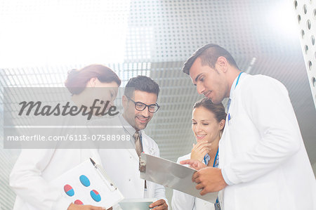 Doctors  consulting in hospital Stock Photo - Premium Royalty-Free, Image code: 6113-07588988