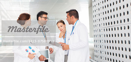 Doctors talking in hospital corridor Stock Photo - Premium Royalty-Free, Image code: 6113-07588998