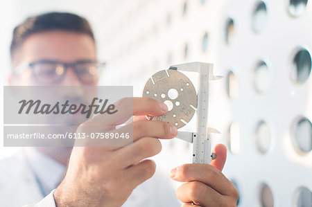 Scientist using calipers Stock Photo - Premium Royalty-Free, Image code: 6113-07589046