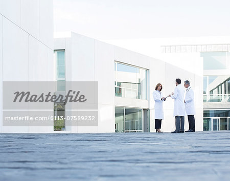 Doctors talking on rooftop Stock Photo - Premium Royalty-Free, Image code: 6113-07589232