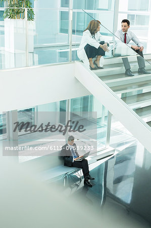 Doctor and administrator talking on hospital stairs Stock Photo - Premium Royalty-Free, Image code: 6113-07589233