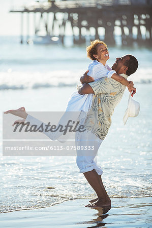 Couple hugging on beach Stock Photo - Premium Royalty-Free, Image code: 6113-07589333
